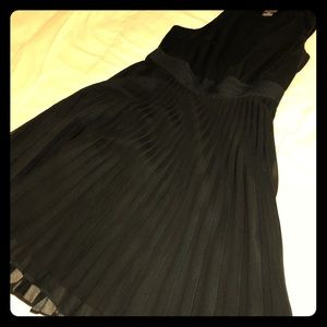 Black dress with pleated skirt.